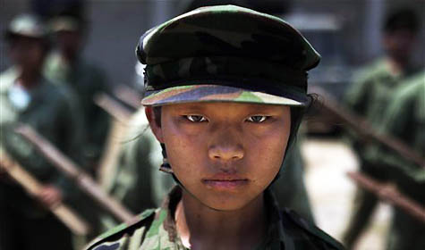 young female recruit of the Kachin Independence Army, one of the country's largest armed ethnic groups, participates in battle drills at a training camp near Laiza in Myanmar