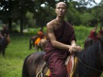 Chiang Rai, Thailand. The monastery, founded by former Thai boxing champion Phra Kru Ba Neua Chai who became a Buddhist monk , takes in destitute children, training them in equestrian skills on horses, many of which have been saved from slaughterhouses, and Thai boxing .