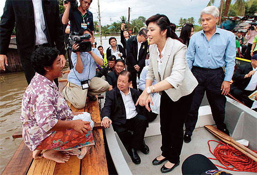 Yingluck Shinawatra says she is Optimistic the Country's Worst Floods in 50 years will Spare Most of Bangkok