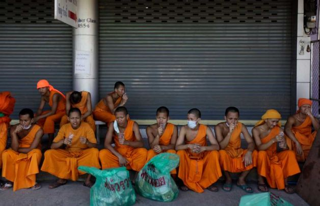 Buddist Monks Clean Up after Flooding in Bangkok