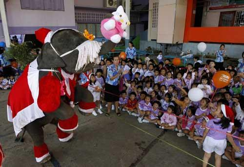 Elephant Santa's Entertain Children in Thailand
