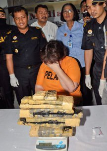 Customs officials were said to have found almost 5kg of cocaine in her luggage