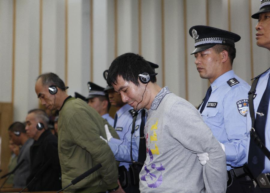 Naw Kham (1st R, front), the principal suspect accused in the Mekong River murder case, and five accomplices hear their verdicts at court in Kunming, capital of southwest China's Yunnan Province