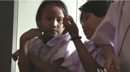9-year-old Nu Nu Wai would like to go to school full time and become a painter