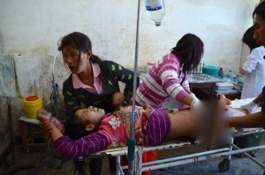Medics at a hospital in Laiza tend to Lamong Kailing, who was injured by the Burma Army shelling outside the town