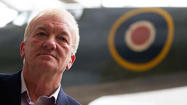 Project leader David Cundall poses in front of a Spitfire plane at the Imperial War Museum in London.