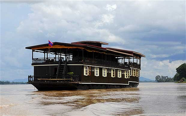 Rather than the larger ships that ply the river in the Cambodian flood plains, I chose to sail in two barges that have been tastefully converted by their French owners