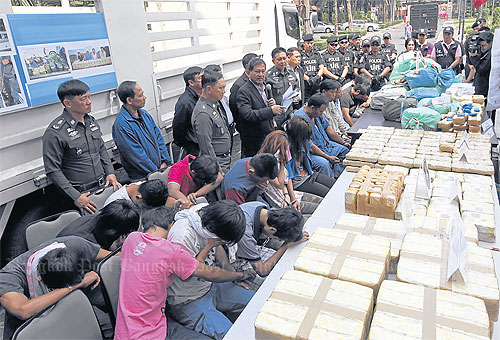 Police joined by Deputy Prime Minister Chalerm Yubamrung announce the seizure of more than 5 million methamphetamine tablets and over 136kg of crystal meth worth a total of 2 billion baht in four separate cases at the Royal Thai Police Office Monday. Several suspects were also brought before the media