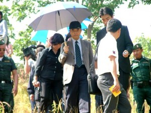 The parents of slain Japanese tourist Tomoko Kawashita visit the scene where their daughter's body was found in Sukhothai province to conduct a religious rite