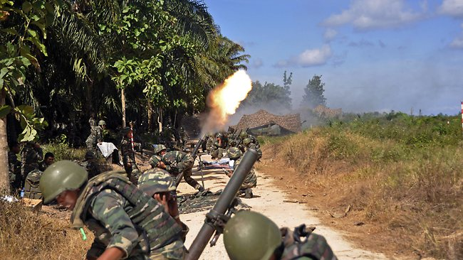 Using airstrikes and mortar fire, Malaysian forces flushed out the clansmen who attacked from the neighbouring Philippines. Picture: AP/ Malaysia's Ministry of Defense.