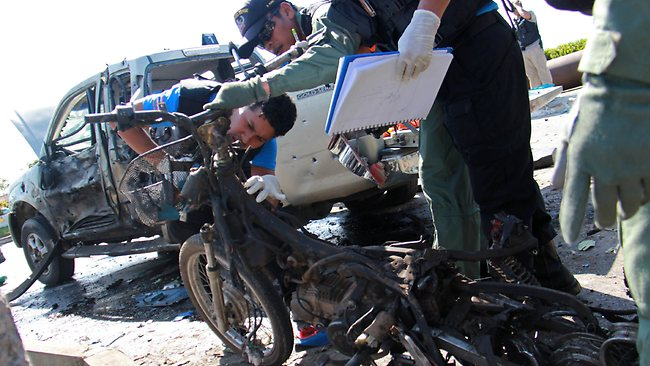 Members of a Thai bomb squad unit inspect the wreckage of a motorcycle caused from bomb attacks by militants in Yala province. Read more: http://www.news.com.au/world-news/thai-bomb-hidden-in-motorcycle-kills-two-wounds-12/story-fndir2ev-1226589185823#ixzz2MOZ1noLX