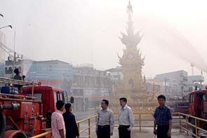 Teams prepare for spraying water around the city in an attempt to reduce the smog