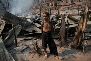 Rescue workers picked through the ashes of hundreds of shelters for Myanmar refugees after a ferocious blaze swept through a camp
