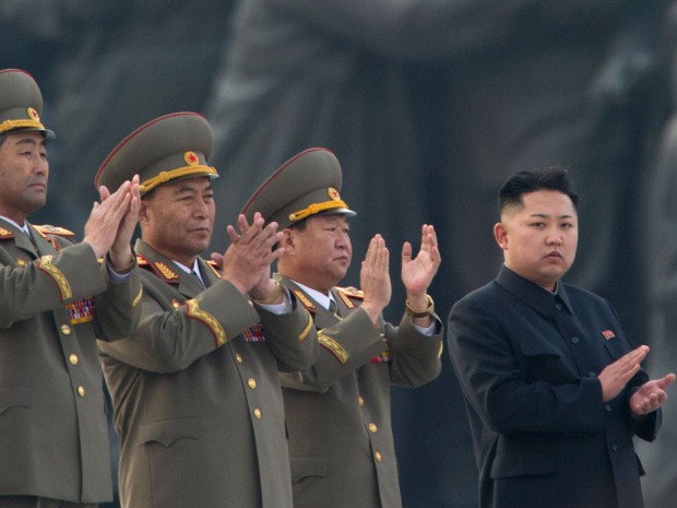 Jong-Un (R) claps during the unveiling ceremony of two statues of former leaders Kim Il-Sung and Kim Jong-Il in Pyongyang.