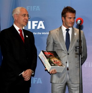 Lord Triesman, pictured here with David Beckham, accused Makudi of demanding the TV rights to a proposed friendly between England and Thailand in return for his vote