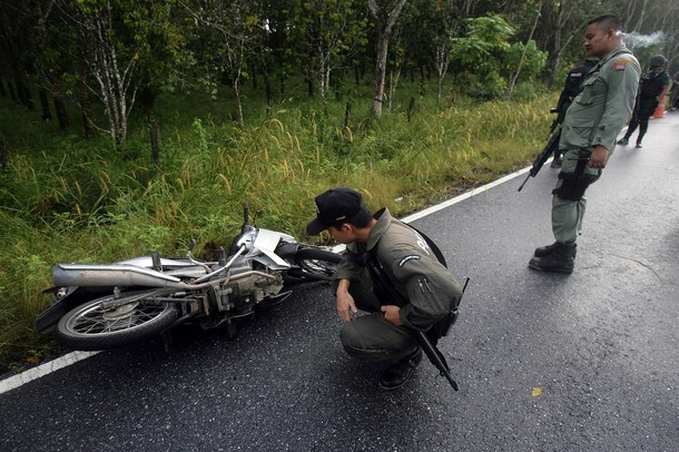 Thai bomb squad members inspect the site
