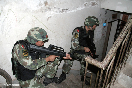 "The anti-drug police are waiting for command during a covert operation in Yunnan Province. In recent years, armed drug trafficking has become a growing threat in the ""Golden Triangle."""
