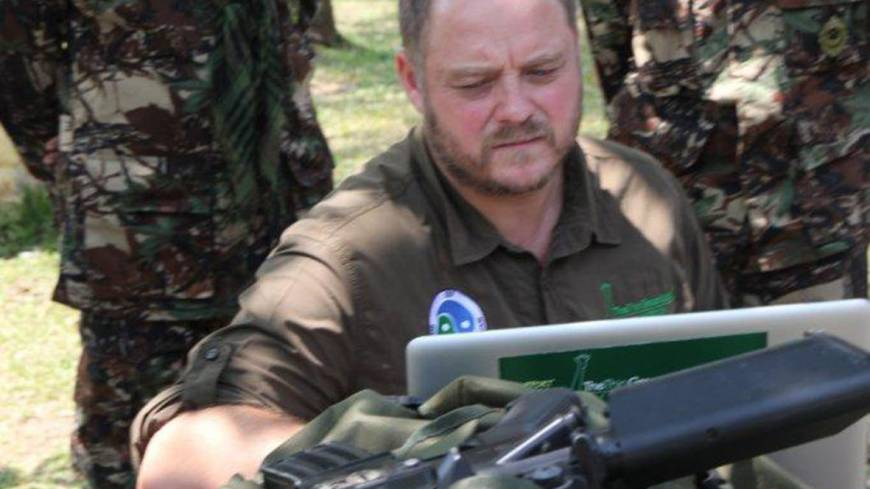Facing facts: Australian Sean Willmore of the International Rangers Foundation shows his 'butcher's bill' of rangers killed to fellow rangers in Khao Yai, Thailand.