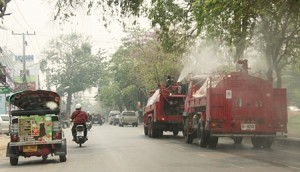 Fire Trucks spraying water into the air to reduce smog
