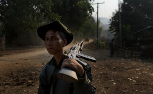 Myanmar army officer patrols close to Mong Pan village, central Shan state, Myanmar.