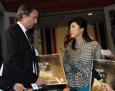 Stuart Chapman, a regional representative of the World Wildlife Fund, presented a petition for a blanket ban on the ivory trade to Prime Minister, Yingluck Shinawatra
