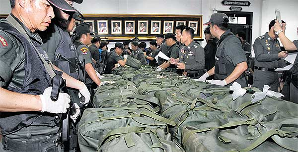 Chiang Rai provincial police in Thailand received a tip-off that a large amount of illegal drugs would be trafficked into the country from Myanmar (Burma). Investigators located a group of suspected drug traffickers who managed to escape, but left behind a pickup truck with 34 backpacks containing 4,080,000 methamphetamine tablets. March 2012