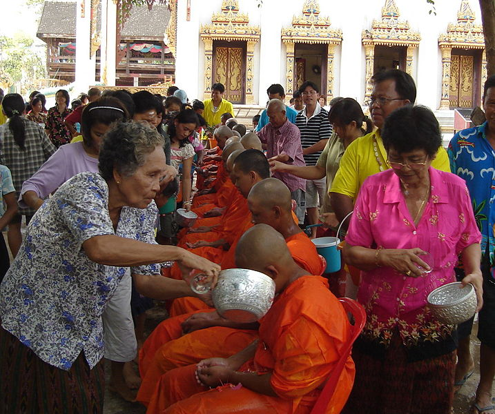 Offering alms to 99 monks, bathing the Buddha