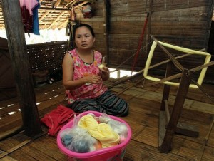 Mu Pro, a 42-year-old Karen refugee weaves while talking during an interview at Mae La refugee camp in Ta Song Yang district of Tak province, northern Thailand. Karen refugees are now facing a future that will dramatically change their constricted but secure, sometimes happy lives