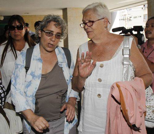 The family of slain Italian journalist Fabio Polenghi, (R-L) mother Laura Chiorri, younger sister Elisabetta Polenghi and elder sister Arianna Polenghi