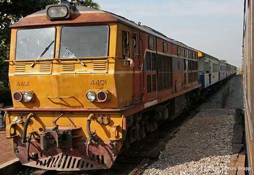 A train ran over an elderly British national lying on the tracks Monday, severing his leg, Thai police said.