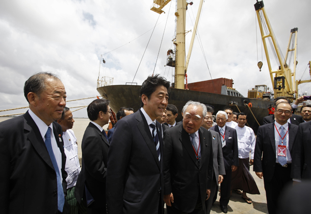Japan's Prime Minister Shinzo Abe (front, second left) visits the Myanmar International Terminals Thilawa (MITT) port outside Rangoon
