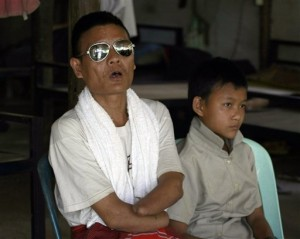 Saw Pa Taw, left, a former Karen fighter who lost both his eyes and hands, during fighting with Myanmar soldiers talks as and son Ta Ye Thu, 13, listens during an interview at Mae La refugee camp in Ta Song Yang district of Tak province, northern Thailand. Read more here: http://www.idahostatesman.com/2013/05/11/2573185/refugees-face-uncertain-future.html#storylink=cpy