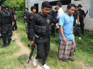 Suspected militants are arrested in Thailand's restive southern province of Narathiwat on May 24, 2013