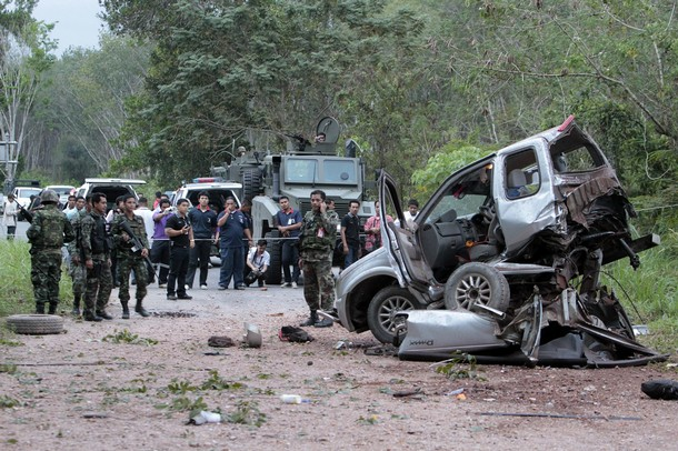 Security personnel investigate the site of an attack in Thailand's southern Yala province