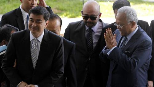 Former Thai Prime Minister Abhisit Vejjajiva (L) and his then deputy Suthep Thaugsuban (R) arrive at the Department of Special Investigation (DSI) in Bangkok