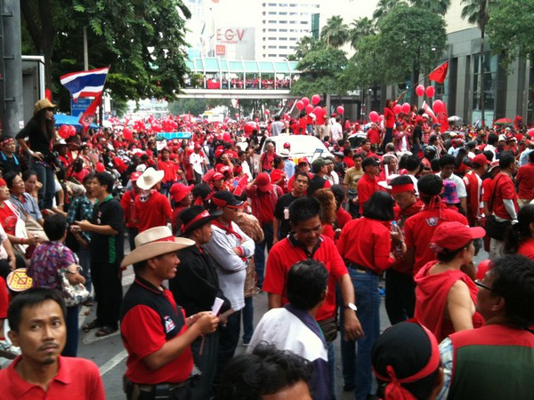 On Sunday roads were blocked as Red Shirts, loyal to ousted self-exiled former leader Thaksin Shinawatra, massed at an intersection in Bangkok's glitzy shopping district.