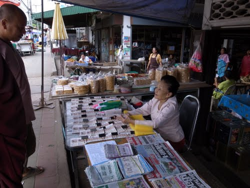 Woman selling Lotto Tickets in Chiang Saen