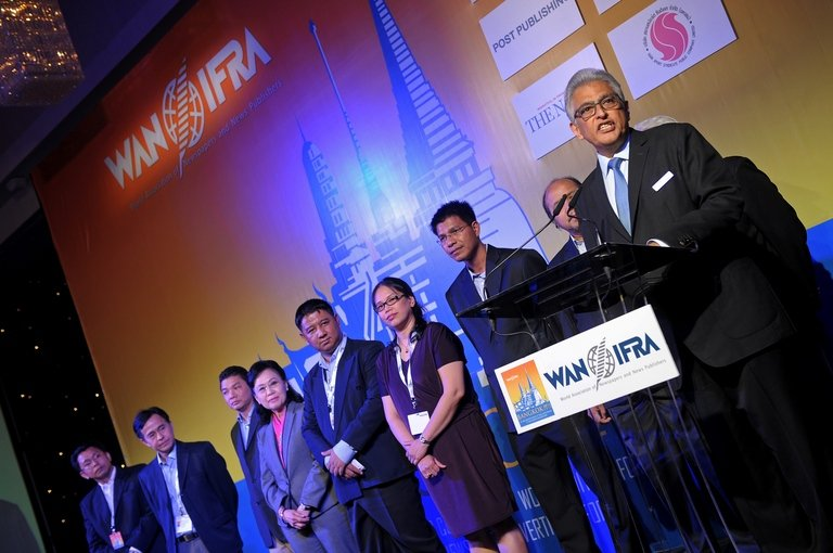 President of the World Association of Newspapers and News Publishers (WAN-IFRA), Jacob Mathew, (R), alongside delegates from local newspapers, addresses the 65th World Newspaper Congress in Bangkok