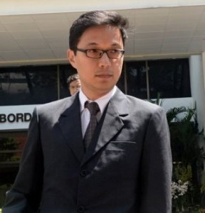 Gary Low, the lawyer for three Lebanese referees accused of accepting free sex for match fixing, leaves a Singapore court on June 10, 2013