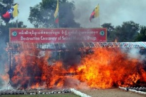 Smokes and flames billow from burning narcotic drugs during destruction ceremony of seized narcotic drugs marking for the international day against drugs abuse and illicit trafficking, in outskirts of Yangon, Myanmar