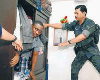 During the raid, several  suspects had  jumped  from the  apartment units, while some hid under their beds, in closets and in the ceiling