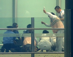 Medical workers and policemen at Beijing International Airport on Saturday, after a man set off a homemade bomb.