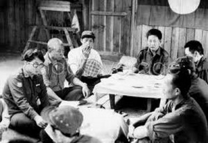 """A screen grab from the 1974 documentary film """"Opium Warlords"""" shows the late Lo Hsing Han conducting a meeting of his drug cabal. Lo is at the head of the table on the right."""