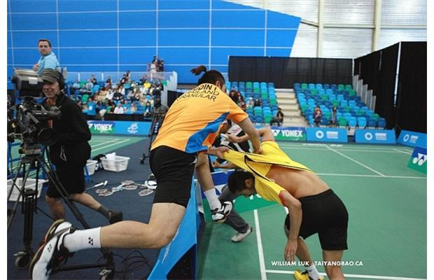 Two men who represented Thailand in badminton at the 2012 Olympics argued and brawled during a doubles match at an international badminton tournament in Vancouver on Sunday, leading to their disqualification