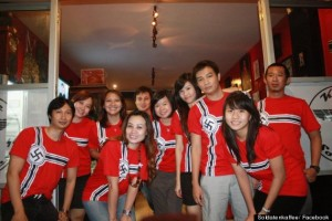 Staff in swastika motif uniforms pose for a shot on the cafe's Facebook page