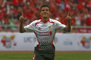Liverpool's Philippe Coutinho celebrates after scoring against Thailand's National Team