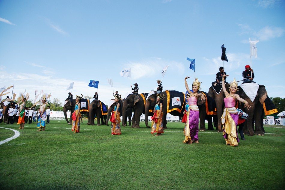 Traditional Thai dancers perform during the opening ceremony for King's Cup Elephant Polo 2013 Tournament in Hua Hin