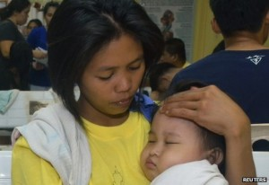 Rescuers brought this woman and her child to a hospital in Cebu