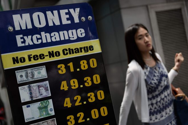 The Thai baht has fallen to a three-year low of 32 against the dollar