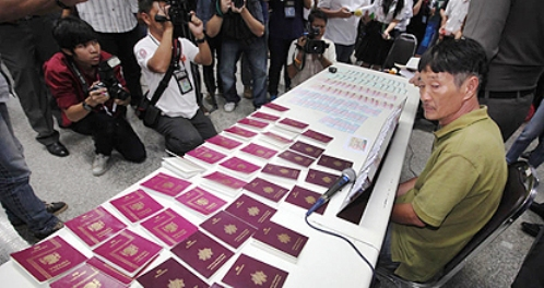 Thai National Arrested with a Bag of Fake Foreign Passports and Visa Stickers